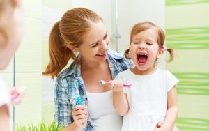 example of parent encouraging child to take care of their teeth