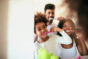 family practicing good dental care